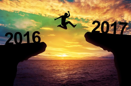 man jumping between cliffs with 2016 and 2017 over each cliff